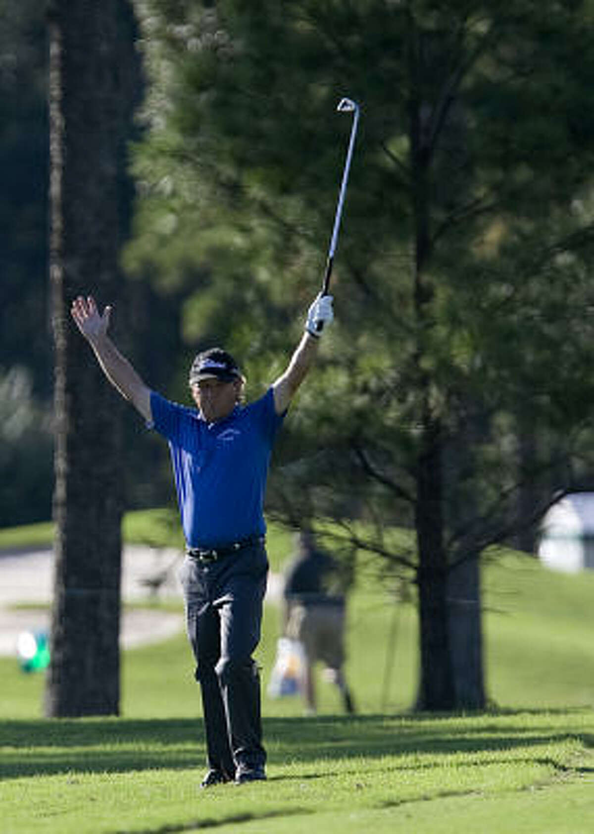 Gene Jones celebrates hitting the ball onto the green on the 18th hole during the second round.
