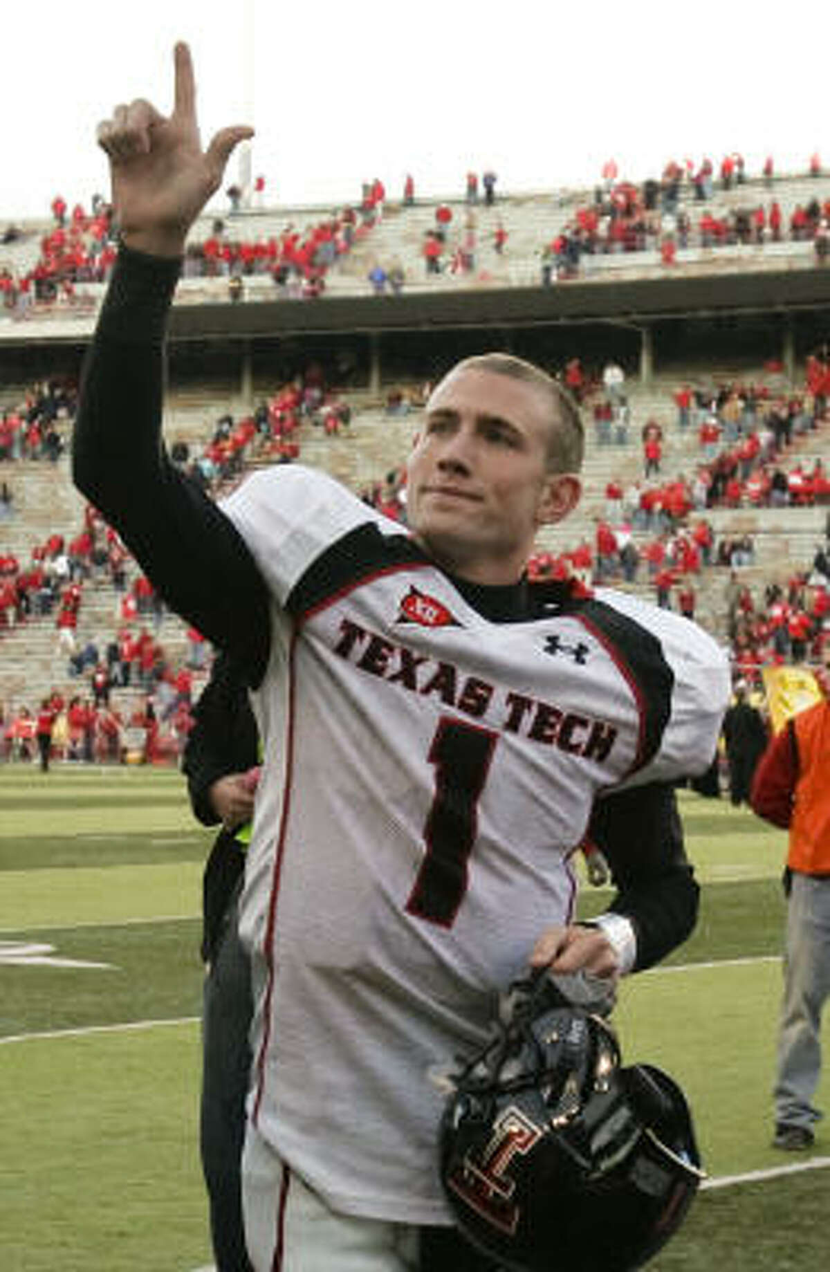 Texas Tech quarterback Steven Sheffield walks off the field after the Red Raiders' victory against Nebraska on Saturday in Lincoln, Neb. Sheffield completed 14 of his first 16 passes.