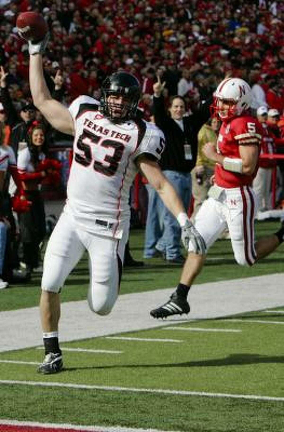 Texas Tech's Daniel Howard celebrates his touchdown after picking up a loose ball in the first half.