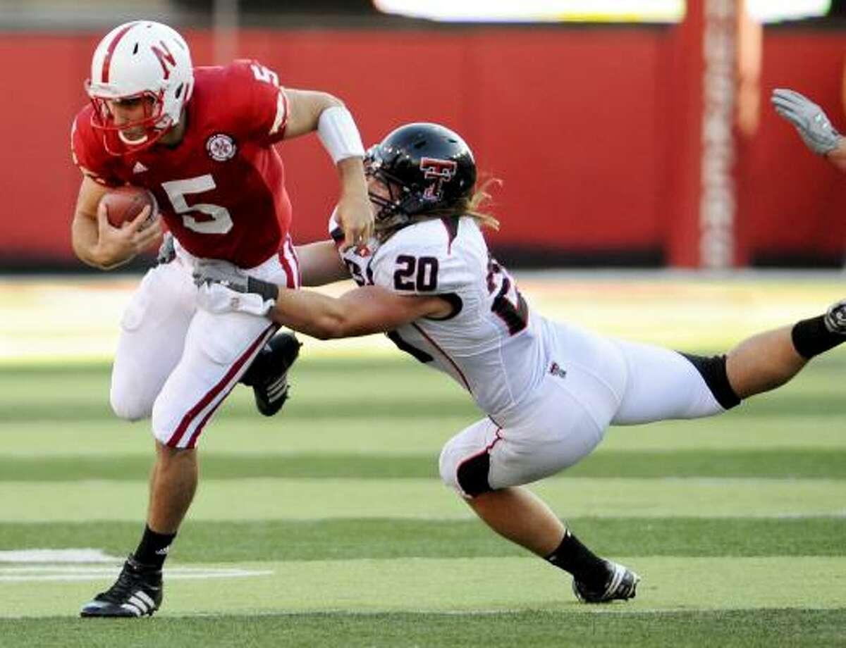 Nebraska quarterback Zac Lee is brought down by Tech's Bront Bird.