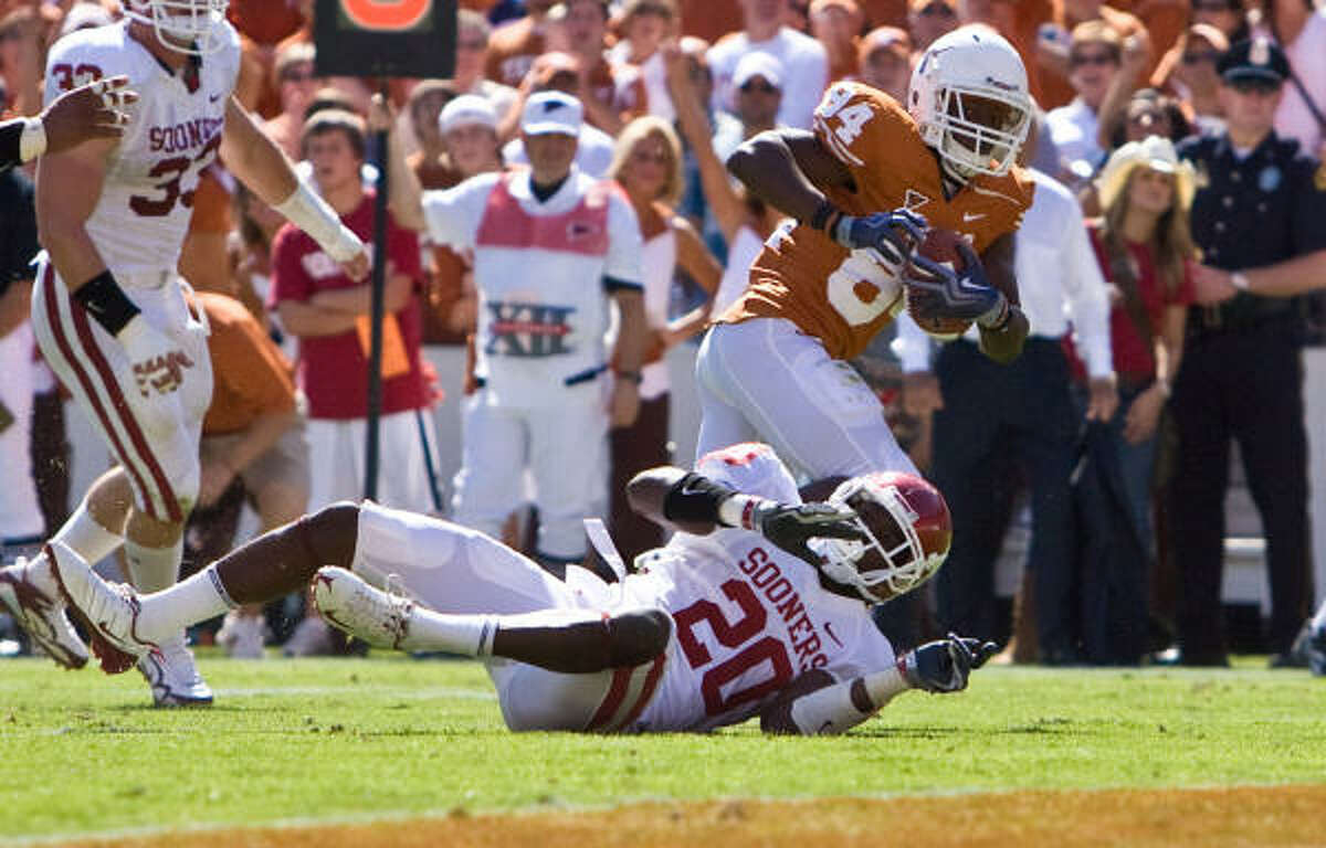 Texas wide receiver Marquise Goodwin runs over Oklahoma defensive back Quinton Carter for the Longhorns' only touchdown.