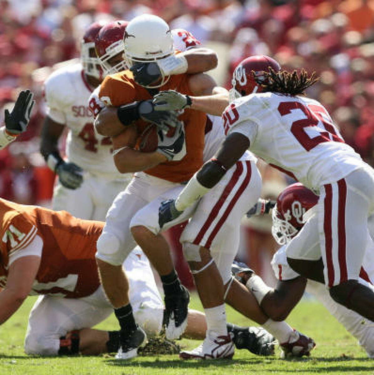 Texas wide receiver Jordan Shipley fights for yardage as Oklahoma defenders bring him down. Shipley was held to 22 yards on four catches.