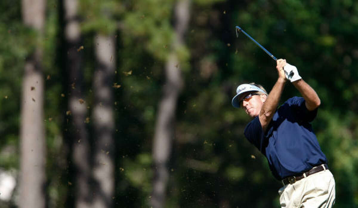 Dan Forsman hits the ball in the fairway at the ninth hole.