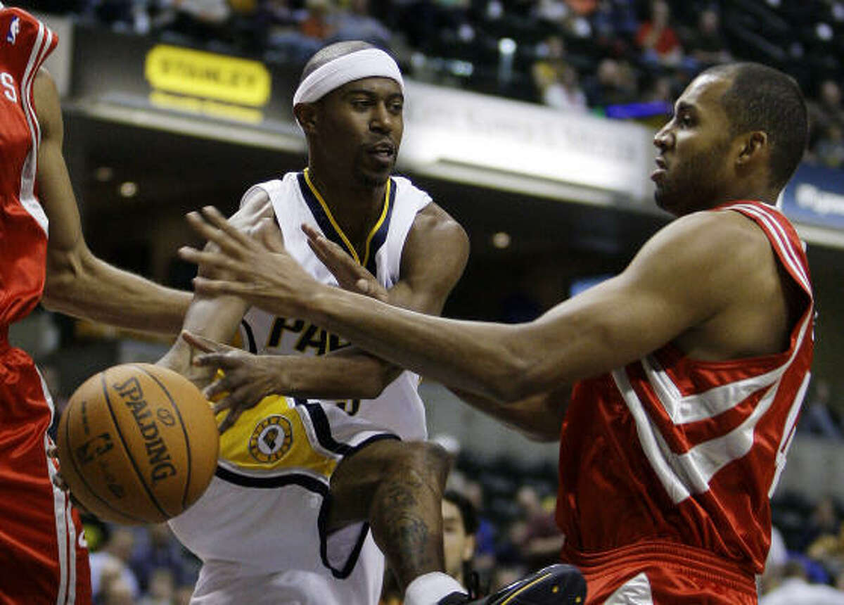 Pacers guard T.J. Ford, formerly of Willowridge High School and the University of Texas, makes a pass as Rockets foward Brian Cook defends.