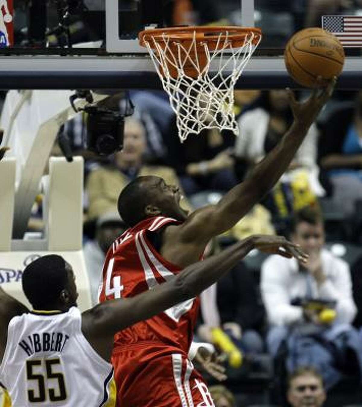Rockets forward Carl Landry, right, puts up a shot against Pacers center Roy Hibbert during the fourth quarter of Friday's game in Indianapolis.