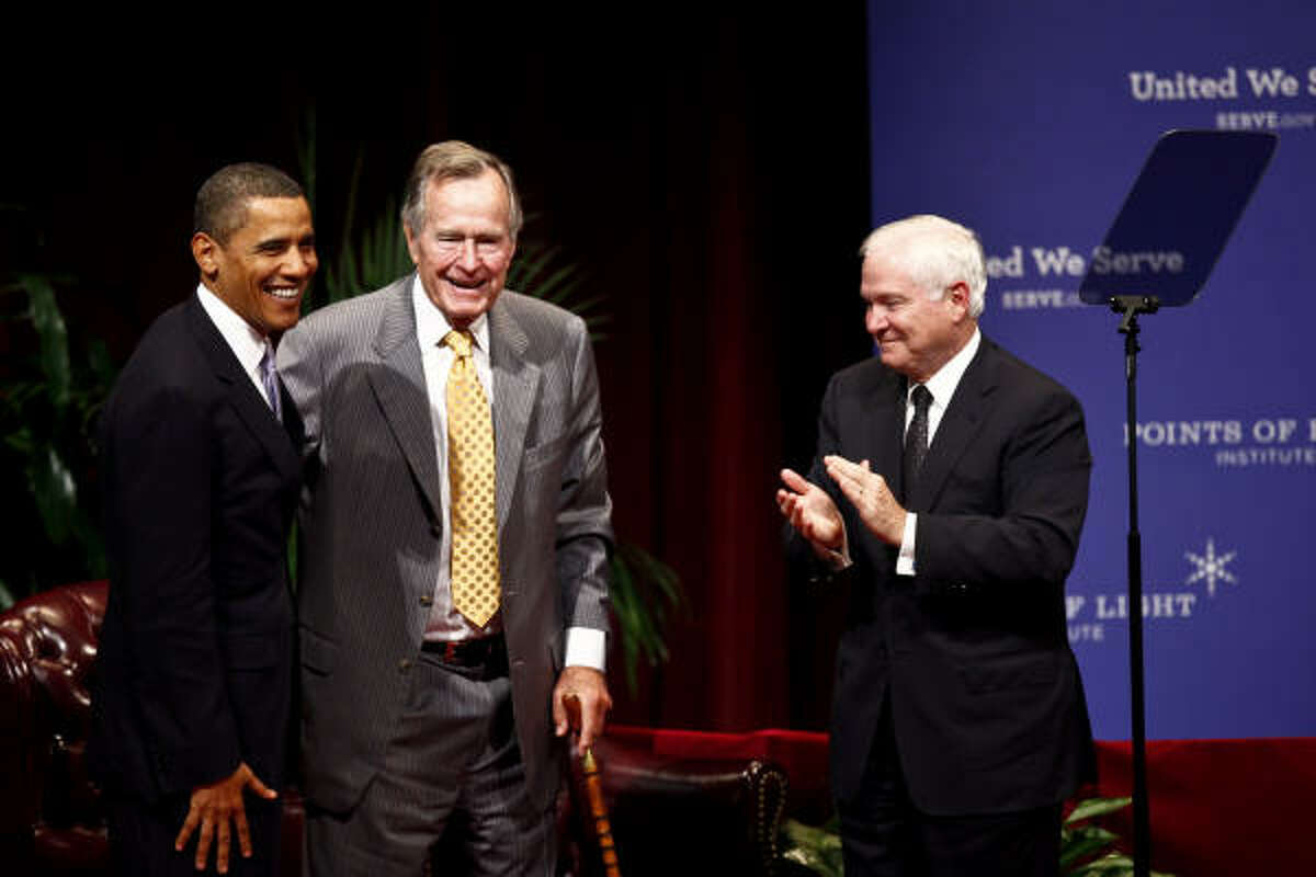 Former President George H.W. Bush and Defense Secretary and former A&M President Robert Gates welcome President Barack Obama to Texas A&M on Friday.