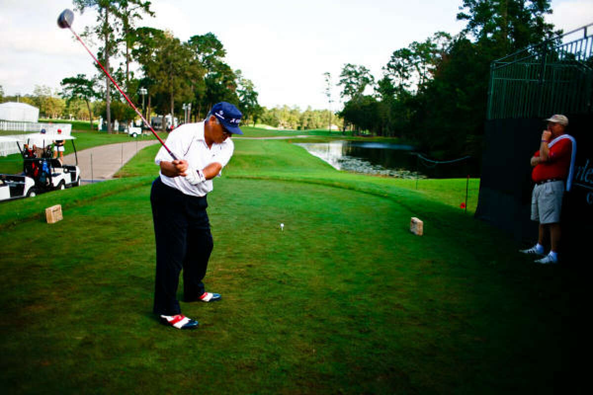 Lee Trevino takes a practice swing before his tee shot during the pro-am.