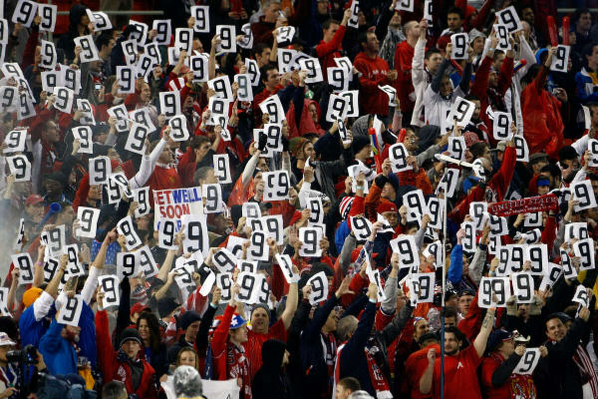 U.S. fans hold up signs for Charlie Davies who was injured in a car accident Tuesday.