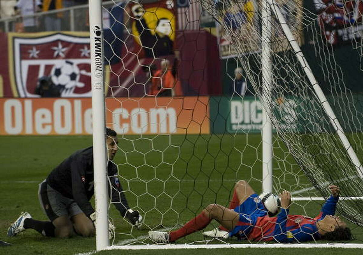 Costa Rica goalkeeper Keilor Navas, left, watches helplessly after Jonathan Bornstein's tying goal. The Ticos were mere seconds or minutes from a berth in the World Cup but will have to beat Uruguay in a home-and-home playoff to advance.