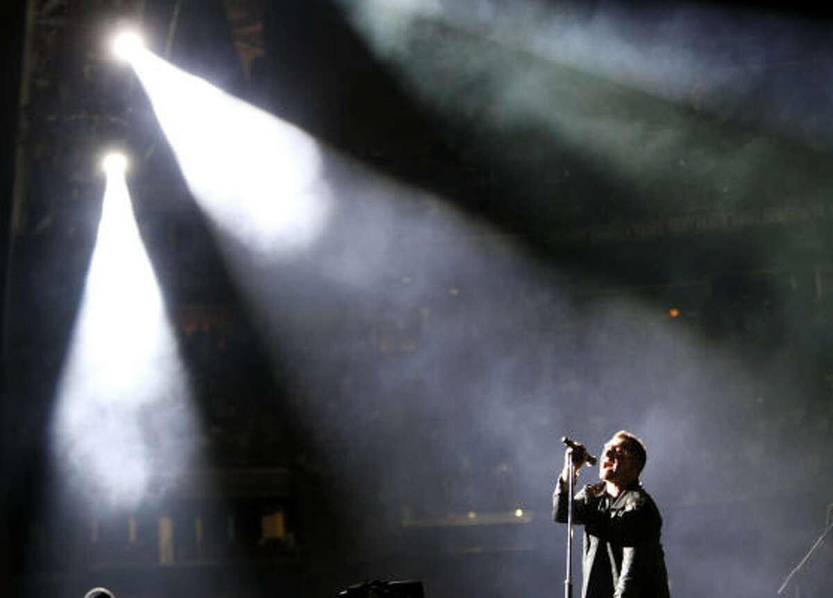 Bono, of U2, performs at Reliant Stadium.