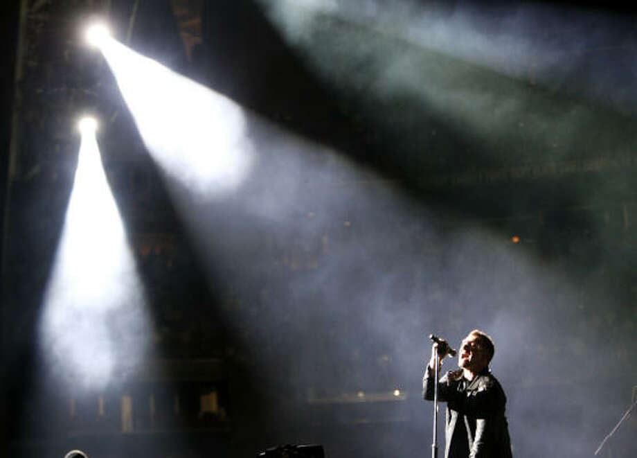 Bono, of U2, performs at Reliant Stadium. Photo: Karen Warren, Chronicle