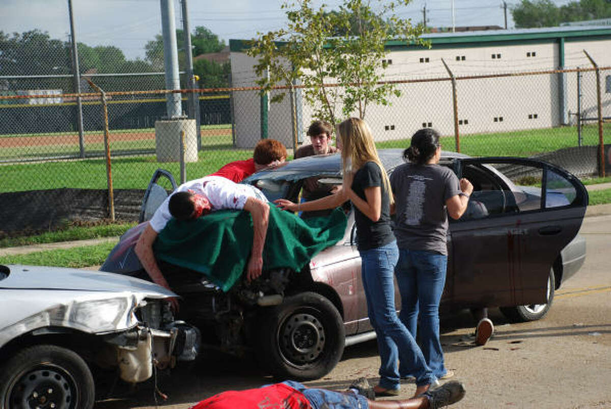 STRATFORD SHATTERED DREAMS: Stratford High School students, teachers and administrators recently participated in a program called Shattered Dreams, a simulated drunk driving scene. Participating are senior Sean Bowman (on car), senior Ashley Tullos, junior Patrick Reilly, senior Sam Gwydir, Greg Dial (teacher on ground) and junior Liana Montemayor.