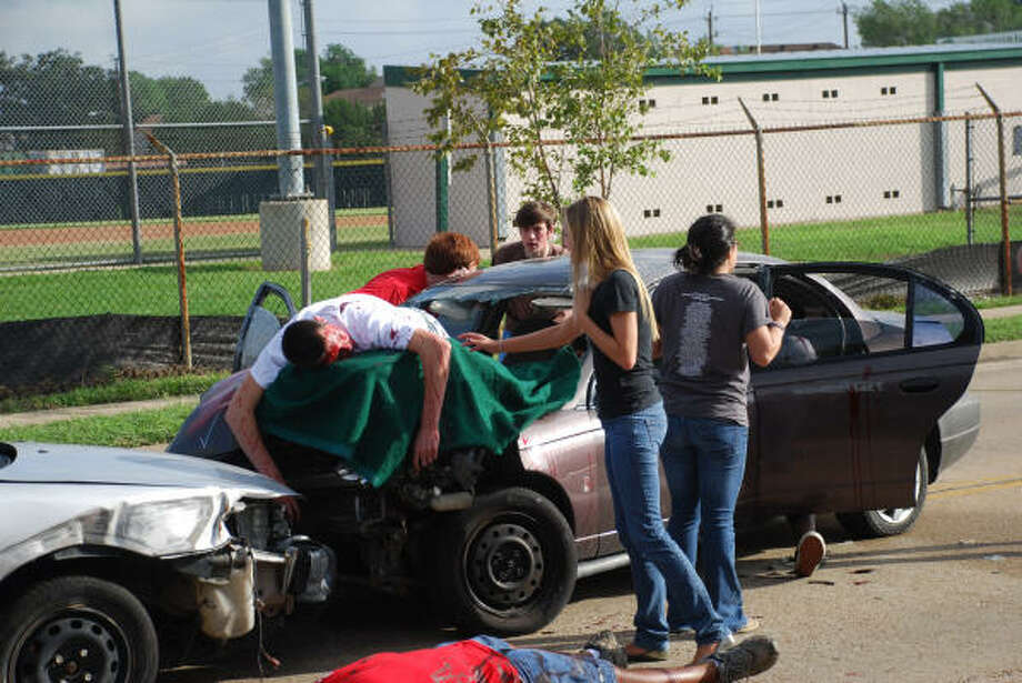 STRATFORD SHATTERED DREAMS:Stratford High School students, teachers and administrators recently participated in a program called Shattered Dreams, a simulated drunk driving scene. Participating are senior Sean Bowman (on car), senior Ashley Tullos, junior Patrick Reilly, senior Sam Gwydir, Greg Dial (teacher on ground) and junior Liana Montemayor. Photo: Courtesy Photo, Bibi Rajeh/Stratford HS