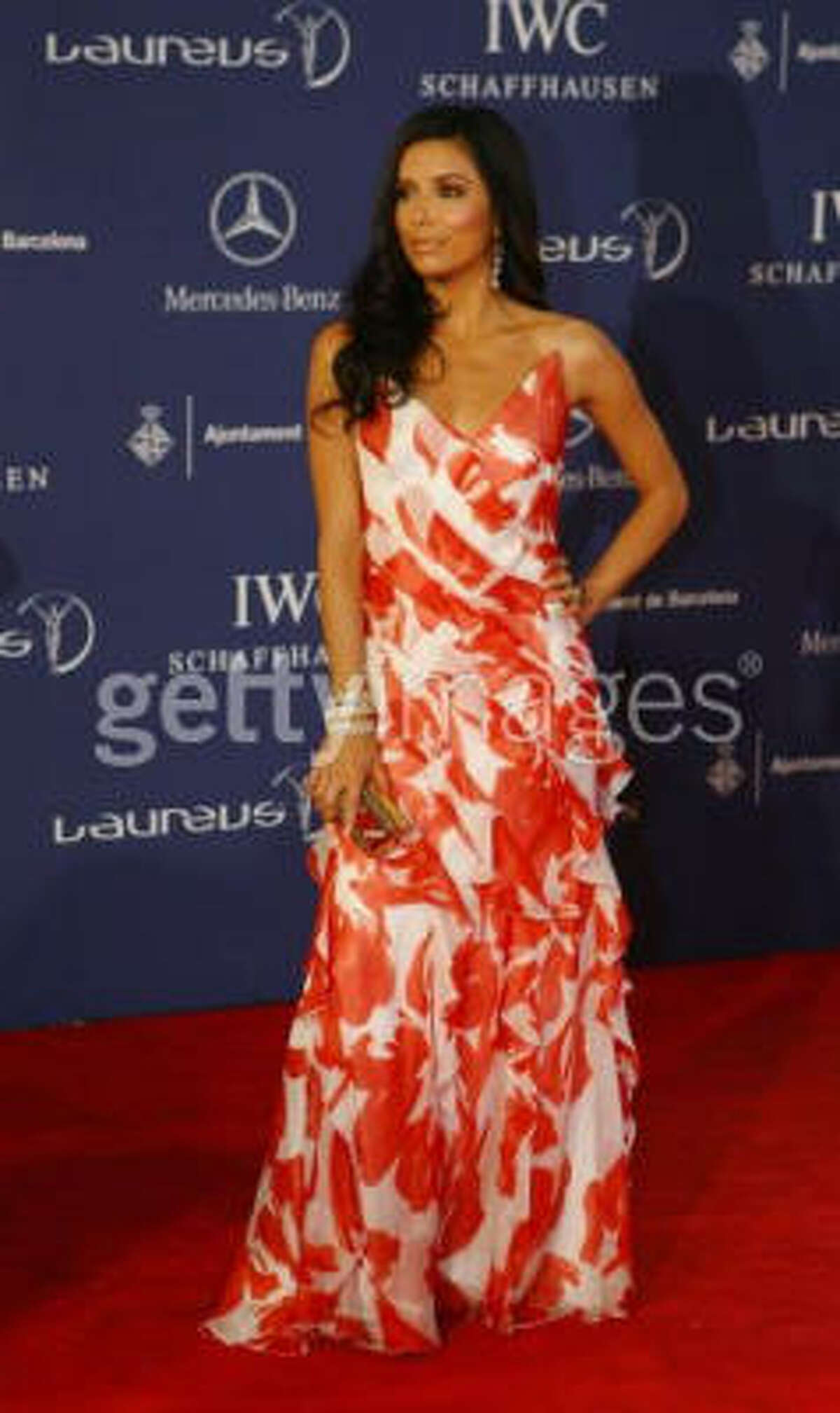 Eva Longoria on the red carpet wearing Carmen Marc Valvo.