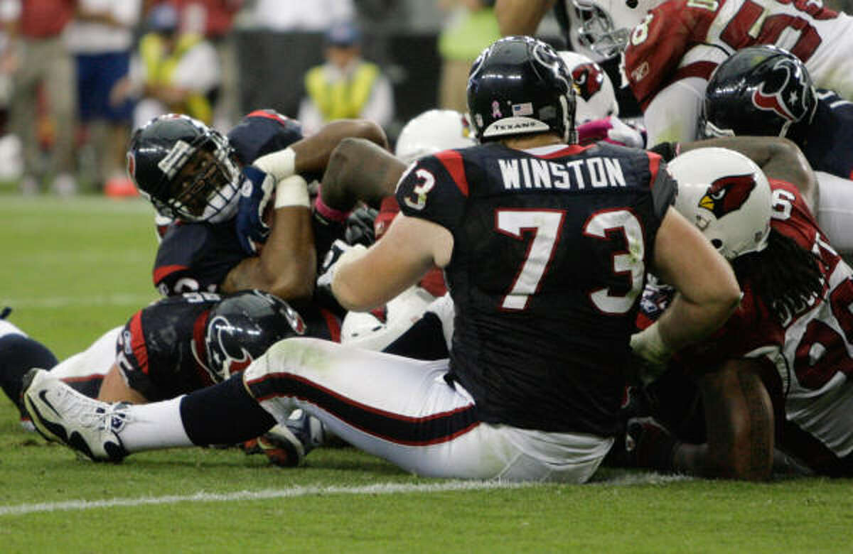 Texans running back Chris Brown is stopped short of the goal line by the Arizona defense in the fourth quarter.