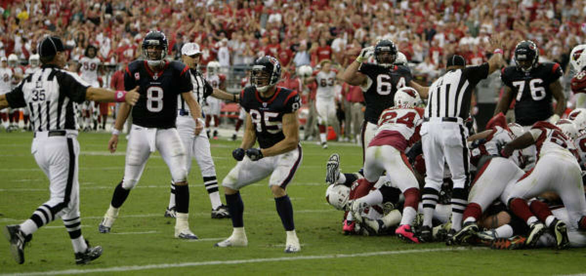 Texans quarterback Matt Schaub (8) and tight end Joel Dreessen plead with the lines judge after the Texans fail to score on fourth down during the final minute.