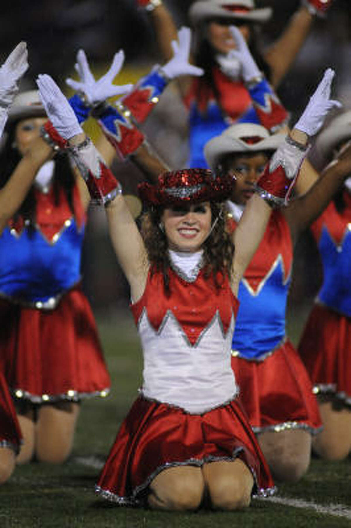 FANS AND BANDS GALLERY: Stephanie Erwin leads the Atascocita High School Patriettes.
