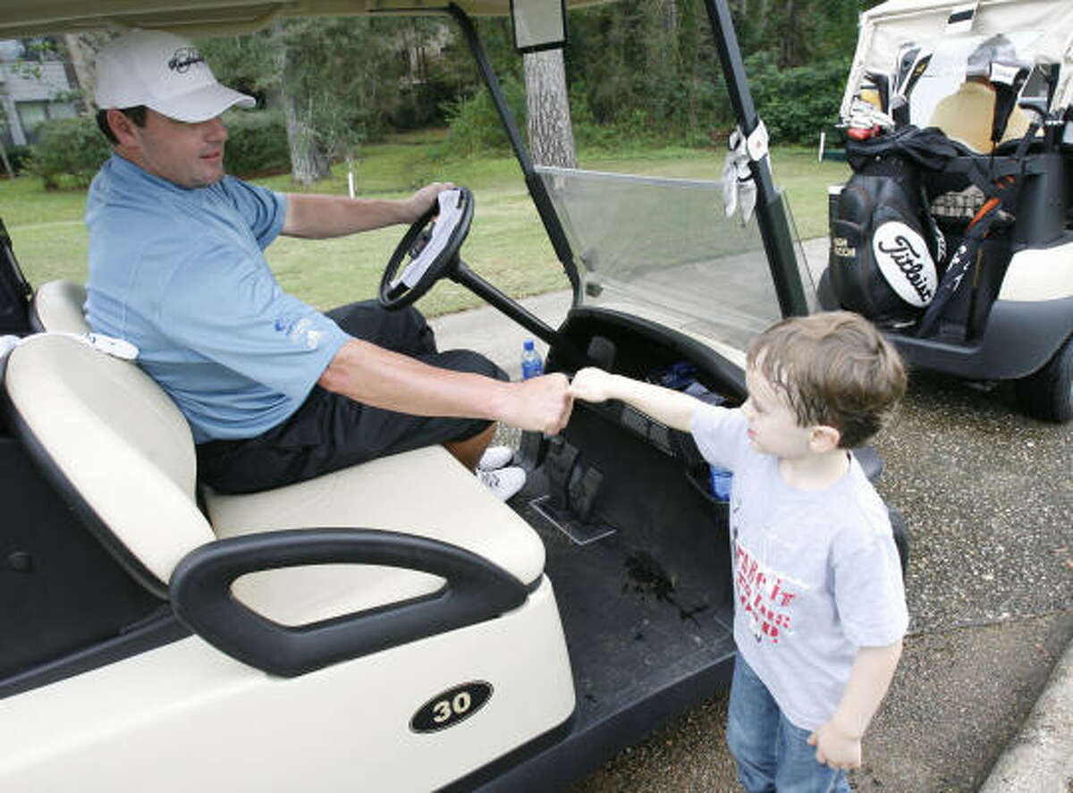 Five-year-old Colton Bennett of The Woodlands gets a fist-bump from former Astros pitcher Roger Clemens after the seven-time Cy Young winner took a shot on the ninth.