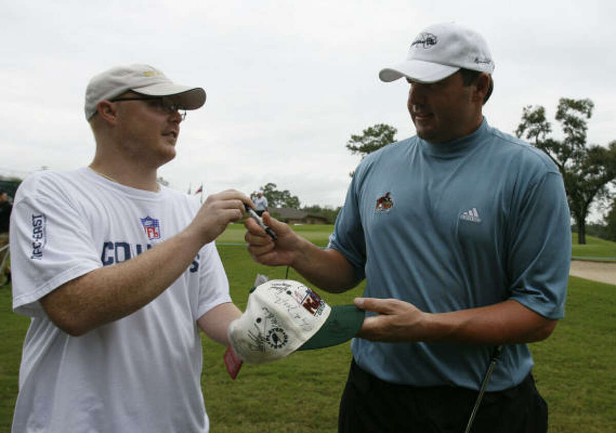 Derek Larson, left, of The Woodlands, talks to Roger Clemens about the current Major League Baseball playoffs after getting an autograph from the All-Star pitcher.
