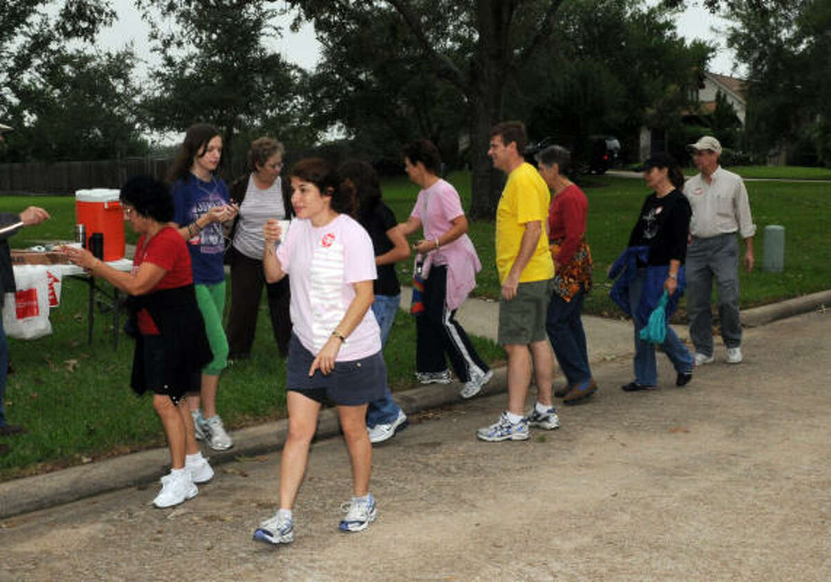 Walkers stop for water during the Bay Area CROP walk, a fundraiser put together by local churches to fight hunger and poverty in the Clear Lake area.