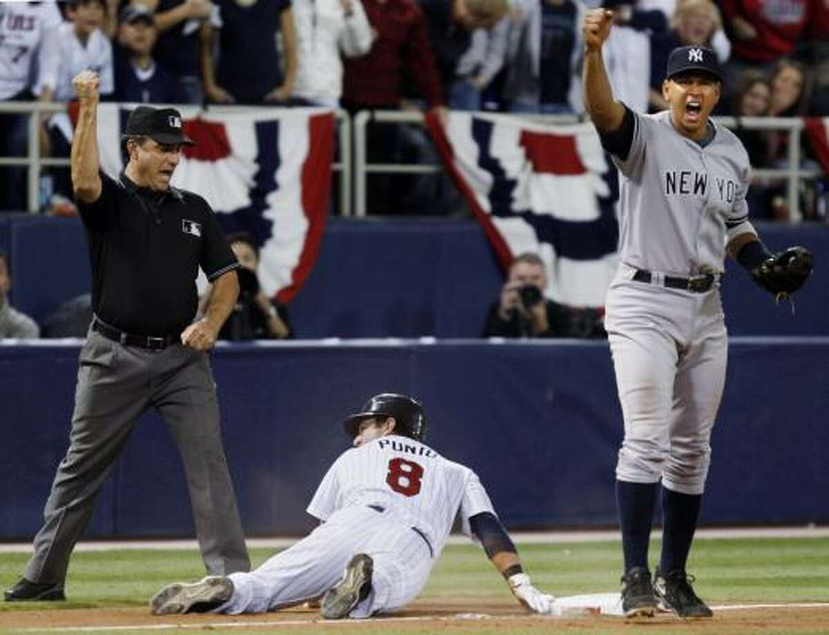 Yankees third baseman Alex Rodriguez reacts after tagging out Twins second baseman Nick Punto during the eighth inning.