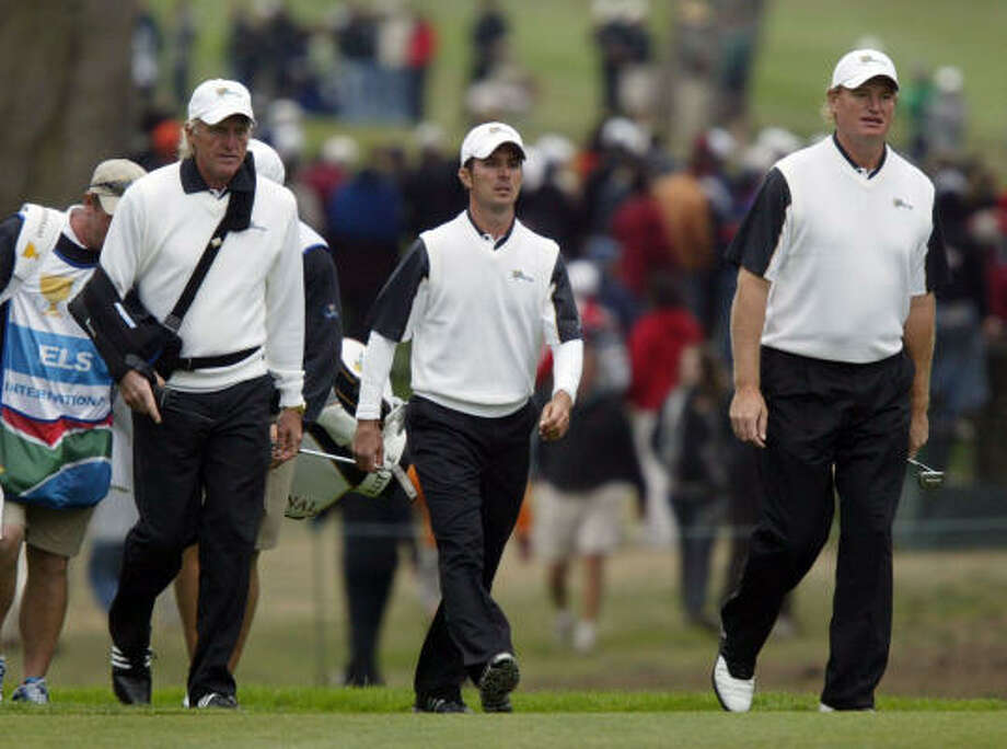 International Team captain Greg Norman, Mike Weir, and Ernie Els walk up to the ninth green during their four-ball match Saturday. Photo: ANDA CHU, MCT