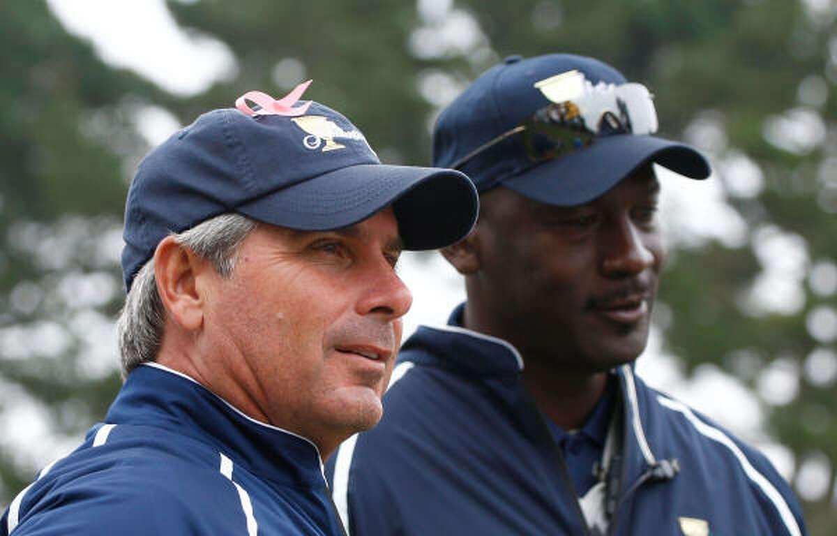 U.S. team captain Fred Couples, left, shown alongside team assistant Michael Jordan.