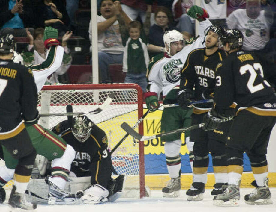 Aeros center Pete Zingoni celebrates a goal late in the first period. Photo: Nathan Lindstrom, For The Chronicle