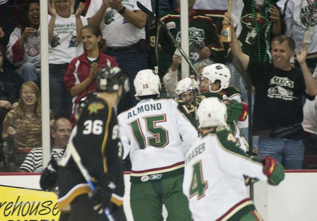 The Aeros celebrate a goal by center Pete Zingoni in the first period.