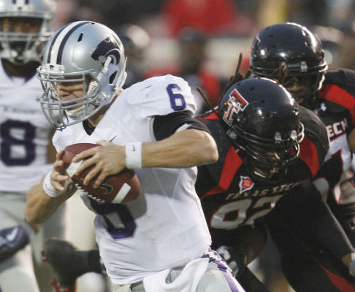 Kansas State quarterback Grant Gregory runs from the Texas Tech defense.