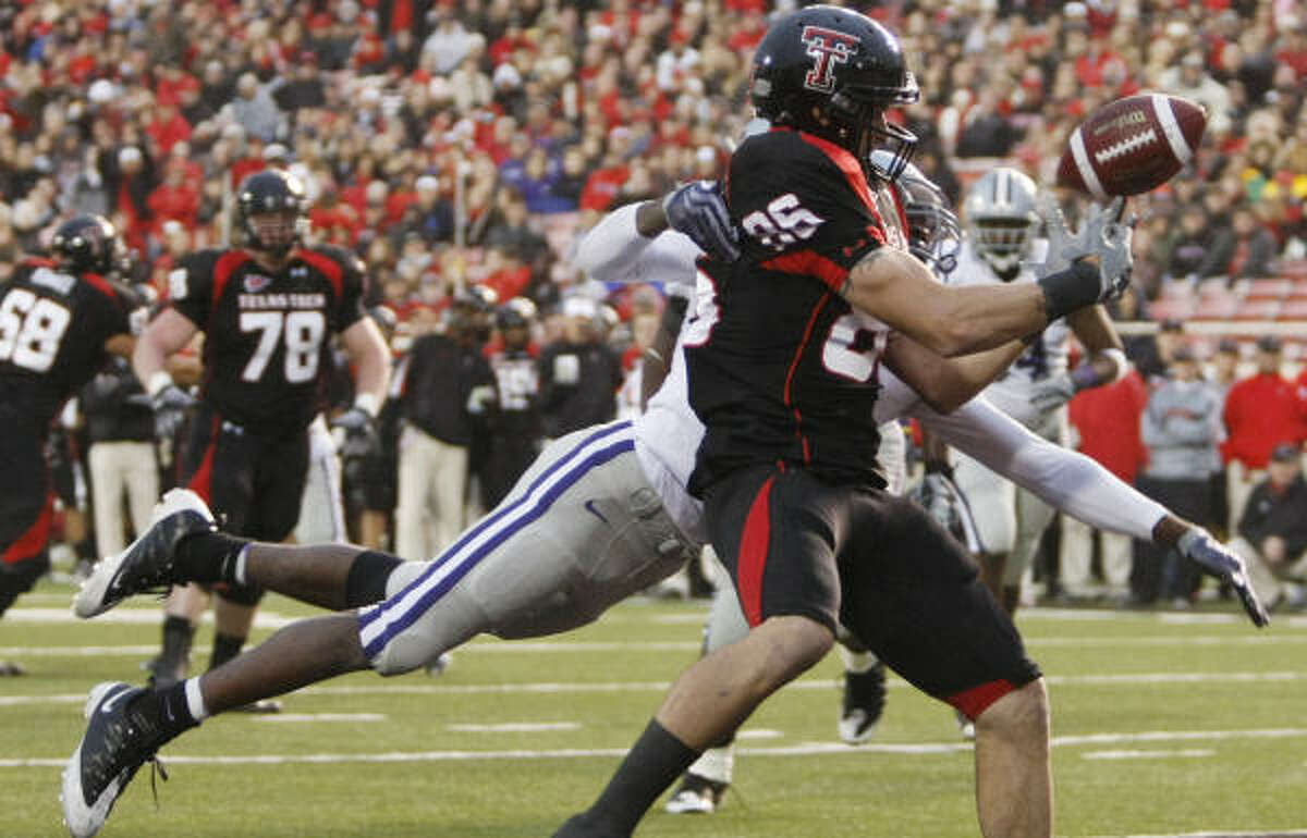 Texas Tech's Alexander Torres tips the ball in the end zone for an incomplete pass in the second quarter as Kansas State's Stephen Harrison defended on the play.
