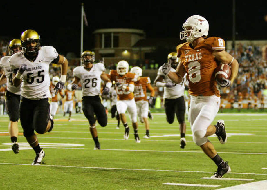 Texas' Jordan Shipley returns a punt 74 yards for a touchdown against the Colorado Buffaloes in the fourth quarter. Photo: Brian Bahr, Getty Images
