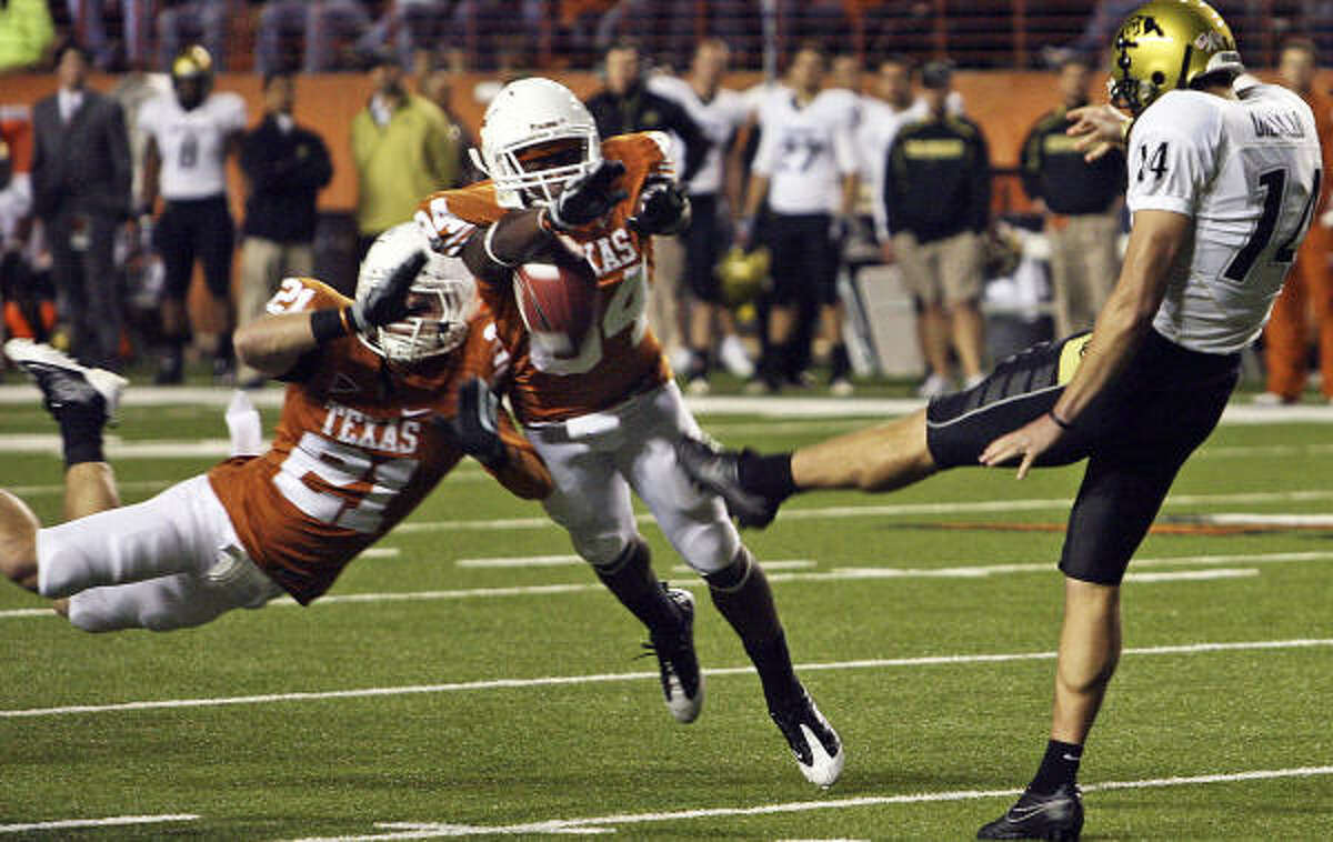 Texas blocks a Buffalo punt, resulting in the go-ahead score for the Longhorns.