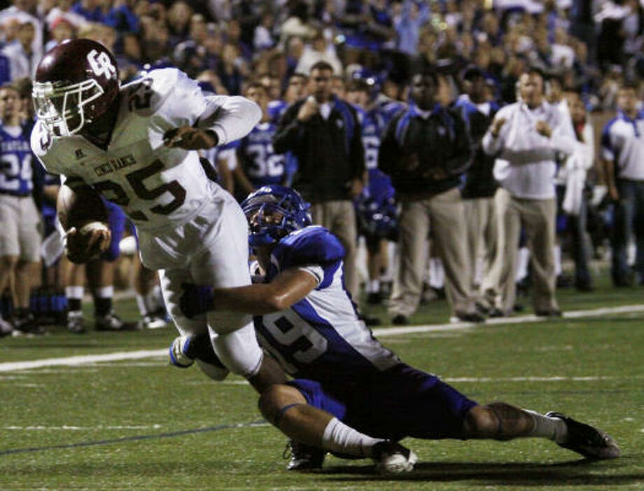 Cinco Ranch 21, Katy Taylor 16Cinco Ranch running back K. C. Nlemchi almost makes it to the goal line as Katy Taylor linebaacker Max Guarniere (19) makes the tackle. Photo: Eric Kayne, For The Chronicle