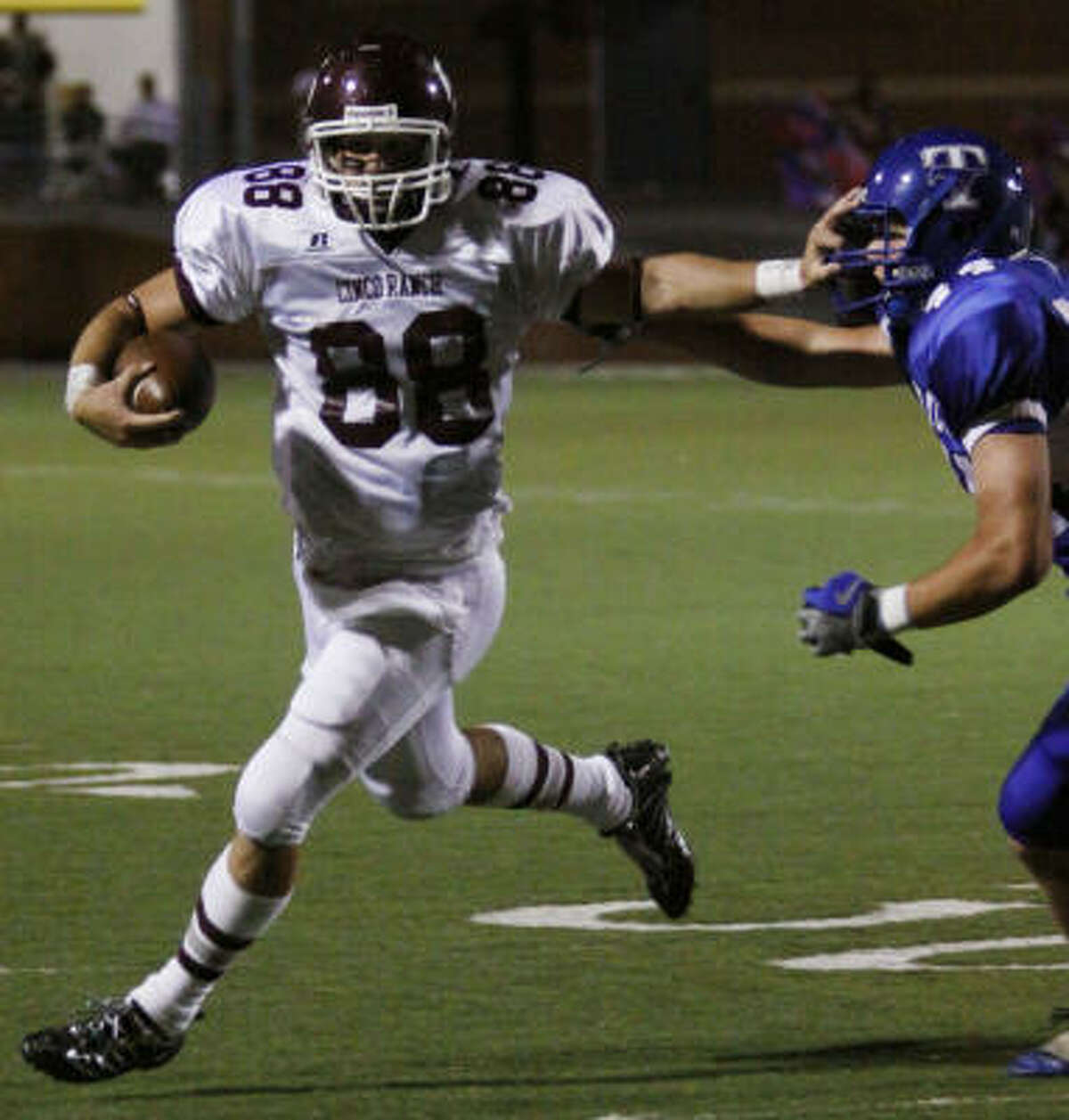 Cinco Ranch receiver Joe Norrell (88) pushes away a Katy Taylor defender.