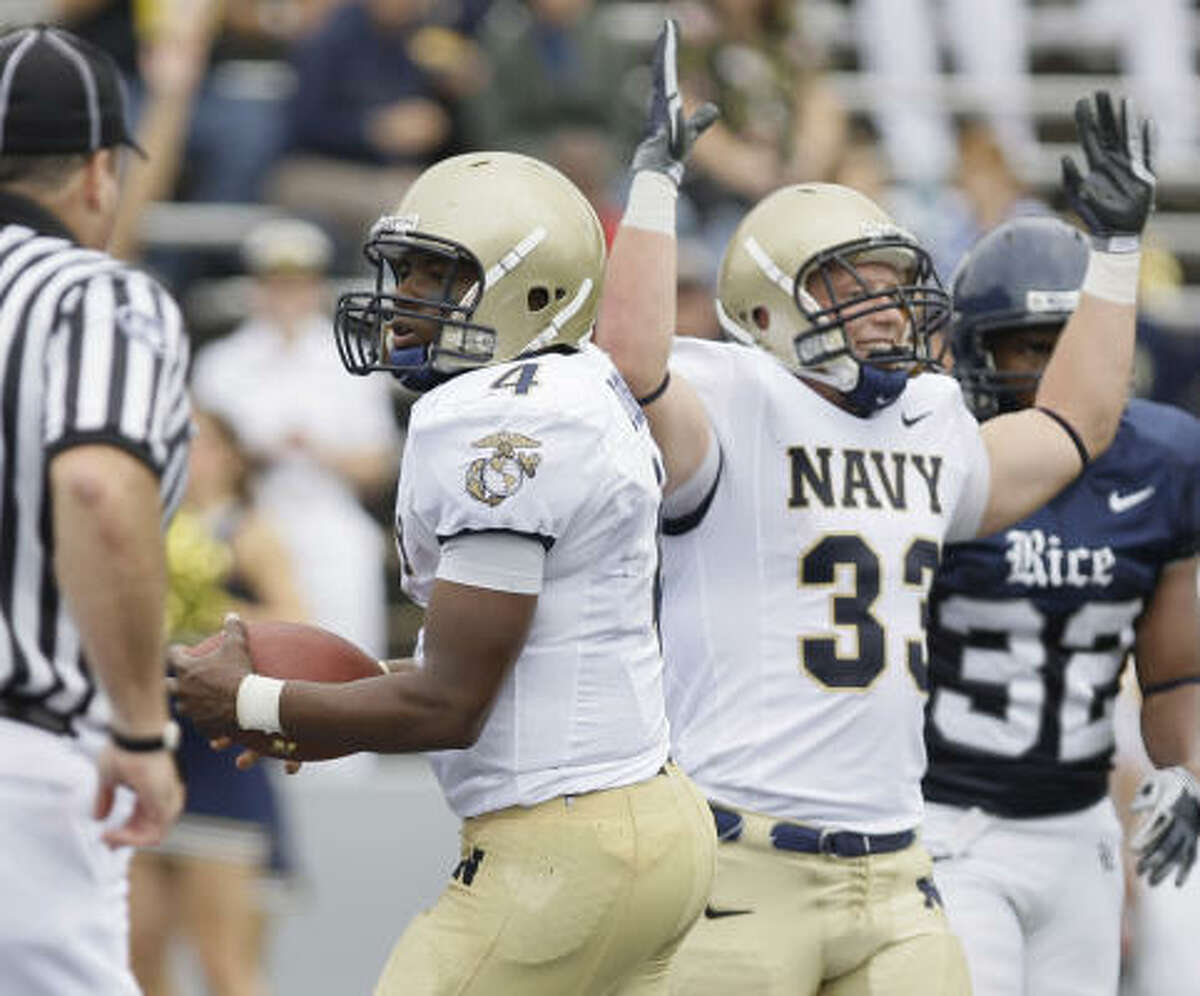 Navy's Bobby Doyle , right, celebrates a second-quarter touchdown by quarterback Ricky Dobbs.