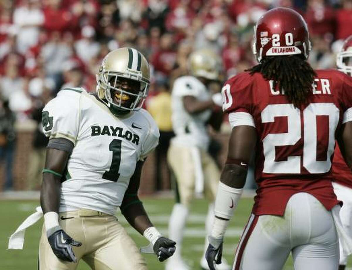 Baylor's Kendall Wright celebrates after pass interference is called on Oklahoma defender Quinton Carter.