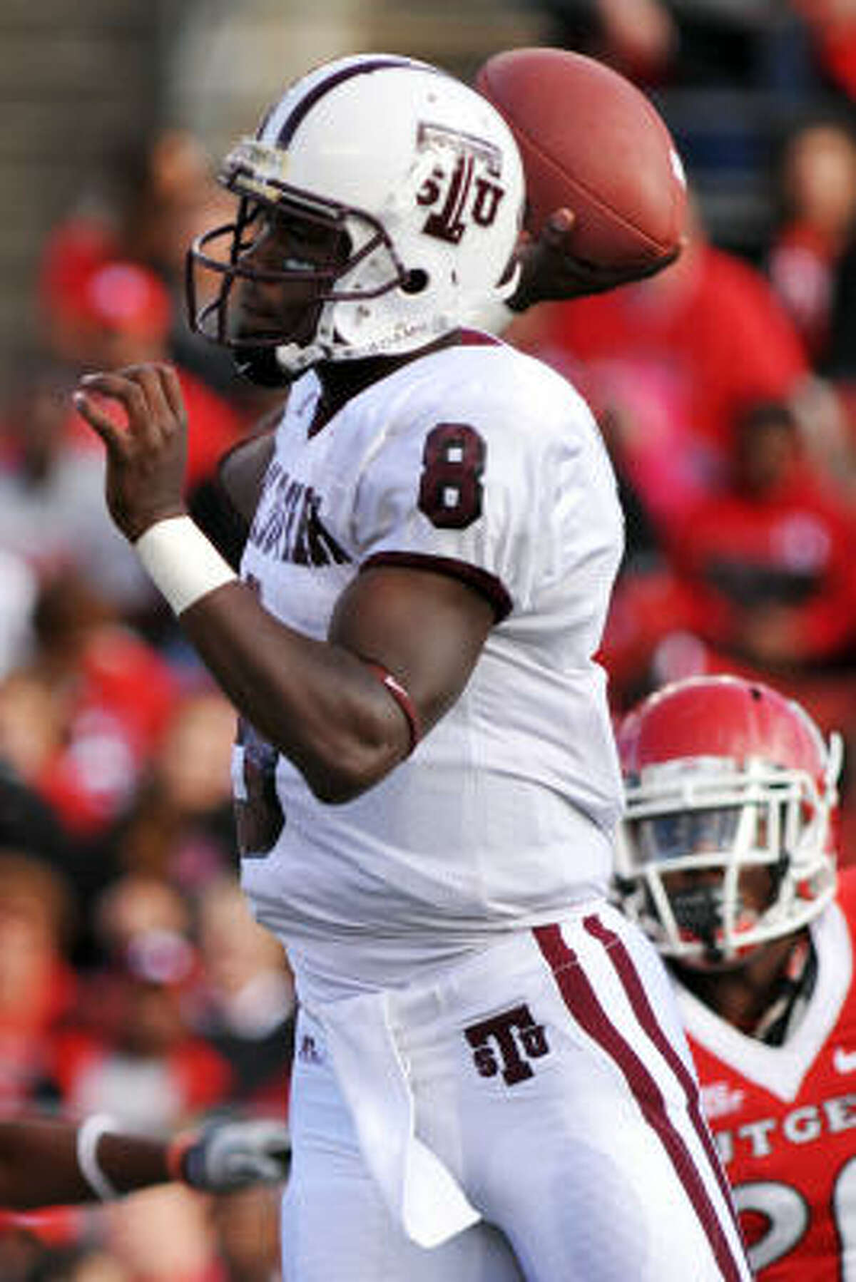 TSU quarterback Arvell Nelson throws a pass during the first half.