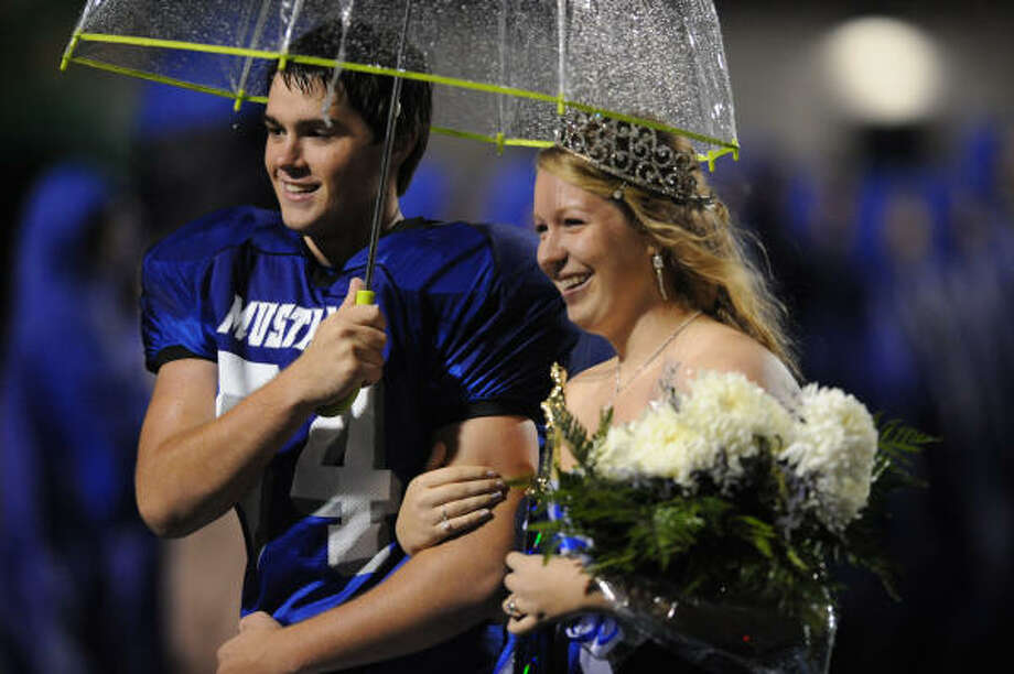 Abbey Rogers, escorted by Alex Lovely, was named Friendswood High School's homecoming queen at Friday's football game. Photo: Ronnie Montgomery, For The Chronicle
