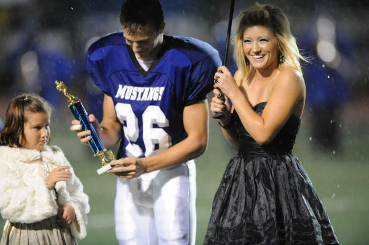 Jessica Kennemer is named football sweetheart at the coronation. She was escorted by her brother Matt Kennemer.
