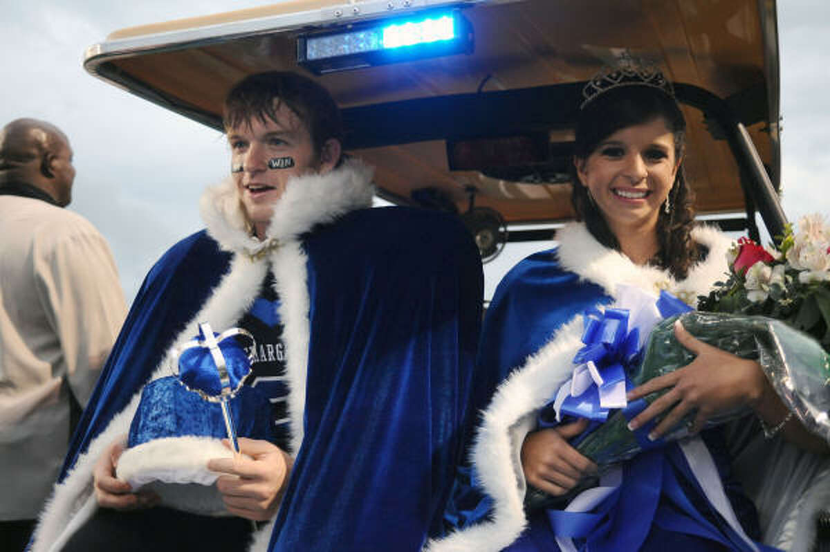 Lisa Caterina and Phillip Miller are named 2009 Clear Springs homecoming queen and king and given a ride around the stadium prior to the game Friday.