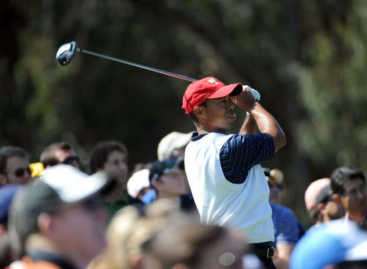 Tiger Woods hits a tee shot on the fifth hole.