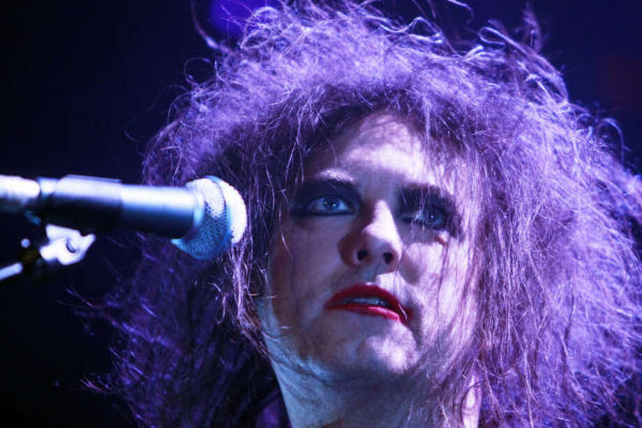 Robert Smith and The Cure still tour. Maybe they are really vampires? That would explain the pale skin, red lips and immortality.  Photo: ROLAND MAGUNIA, AFP/Getty Images