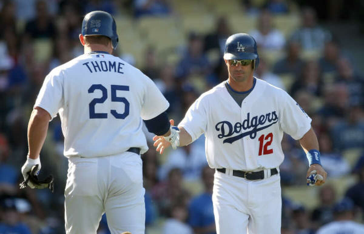 Brad Ausmus, Dodgers Then: The Astros' all-time leader in games caught in two stints (1997-98 and 2001-08) Now: Thriving offensively, by his standards, in very limited playing time, hitting .295 with a .712 OPS in 36 games.