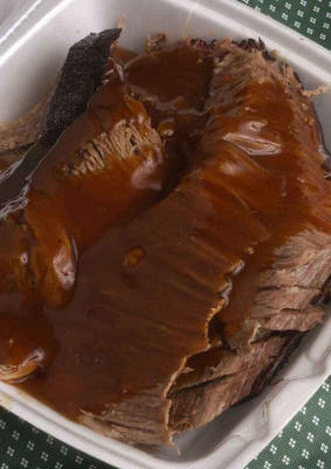 Thelma's Barbecue Beef brisket is a featured dish at 3755 Southmore Blvd.  Wood type is a key ingredient when smoking meat. Some produce a sweeter flavor and others provide a richer, more intense smoke. Photo: Steve Campbell, Houston Chronicle