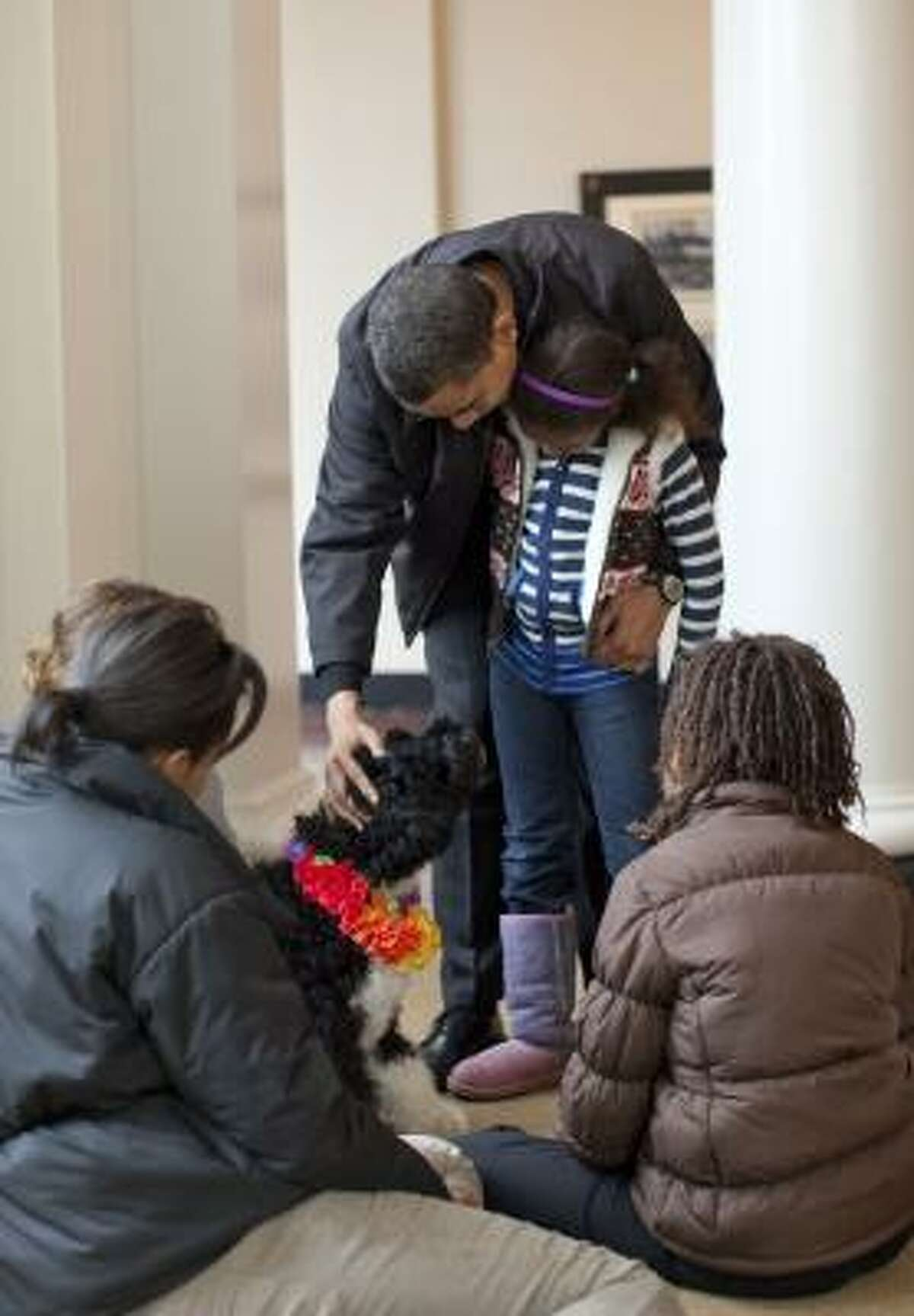The Obama family gets to know their Portuguese water dog, which daughters Sasha and Malia have named Bo. The puppy was a gift from Sen. Edward Kennedy, who had three Porties.
