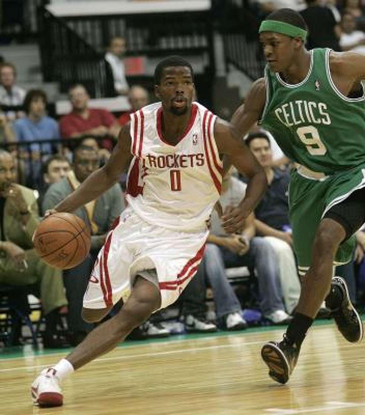 Rockets 96, Celtics 90 Rockets point guard Aaron Brooks drives against Celtics point guard Rajon Rondo during the first quarter.