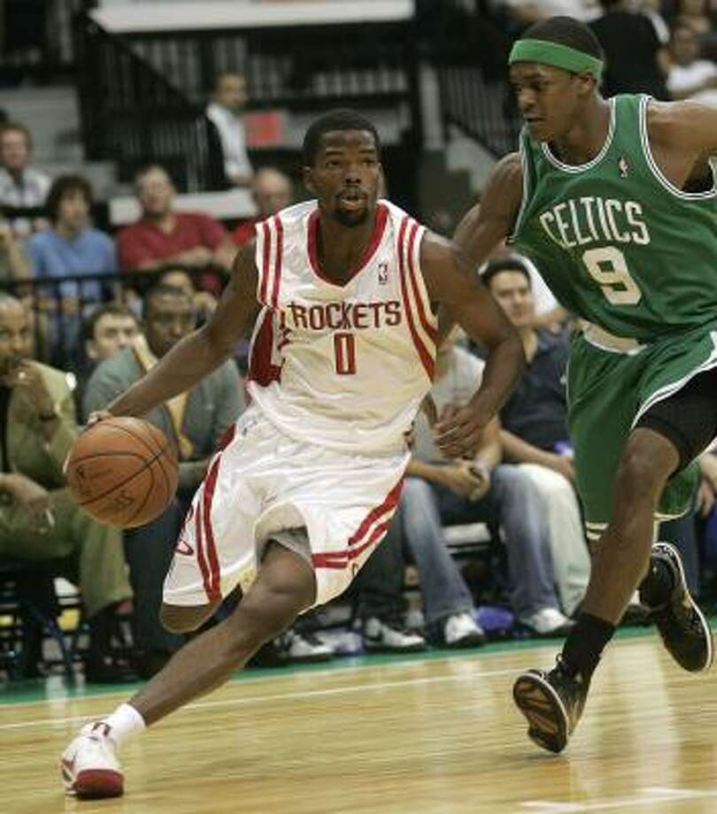 Rockets 96, Celtics 90Rockets point guard Aaron Brooks drives against Celtics point guard Rajon Rondo during the first quarter. Photo: Gabriel Hernandez, AP