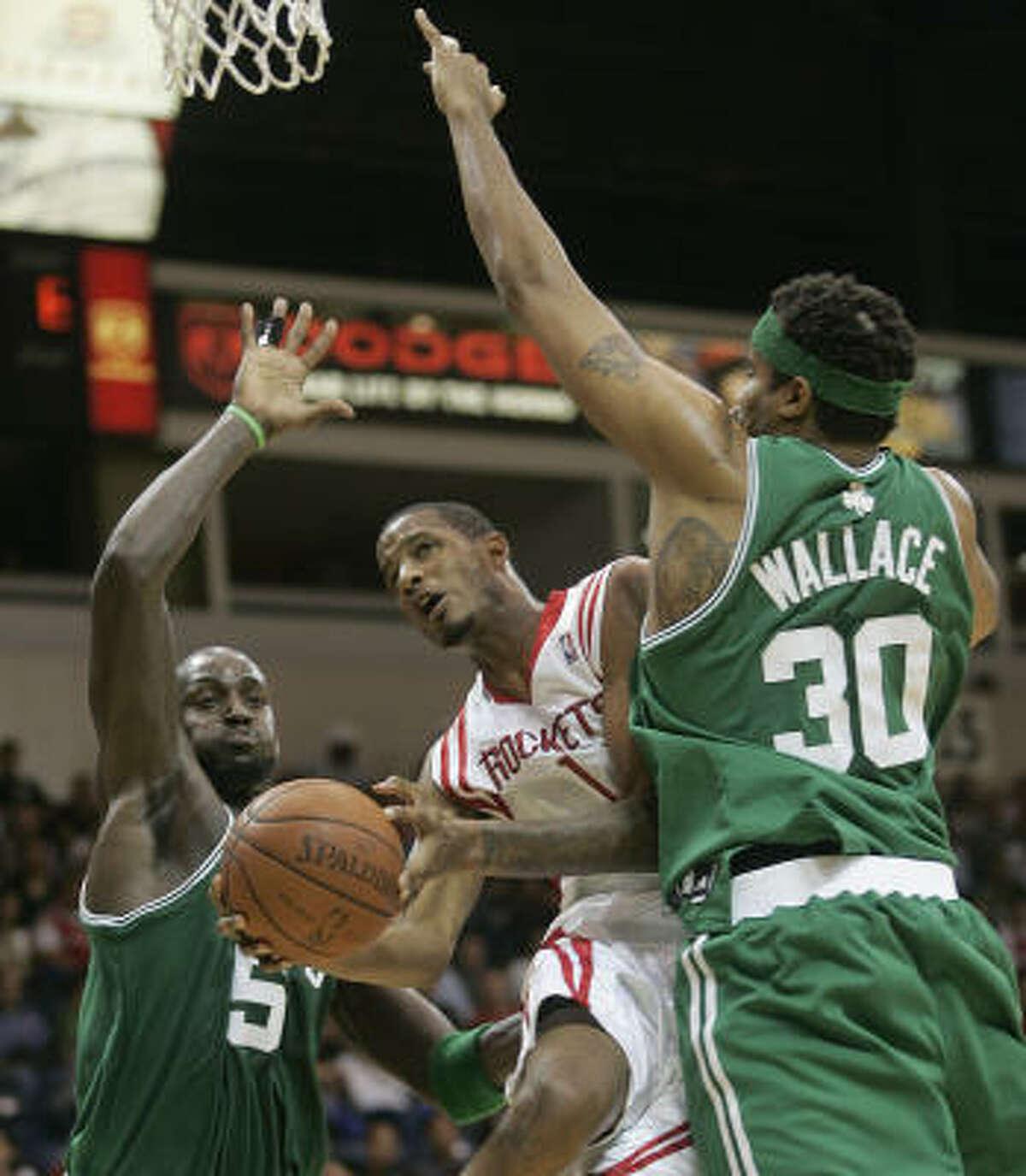 Celtics forwards Kevin Garnett (5) and Rasheed Wallace (30) defend Rockets forward Trevor Ariza. Ariza made one of his 11 shots.