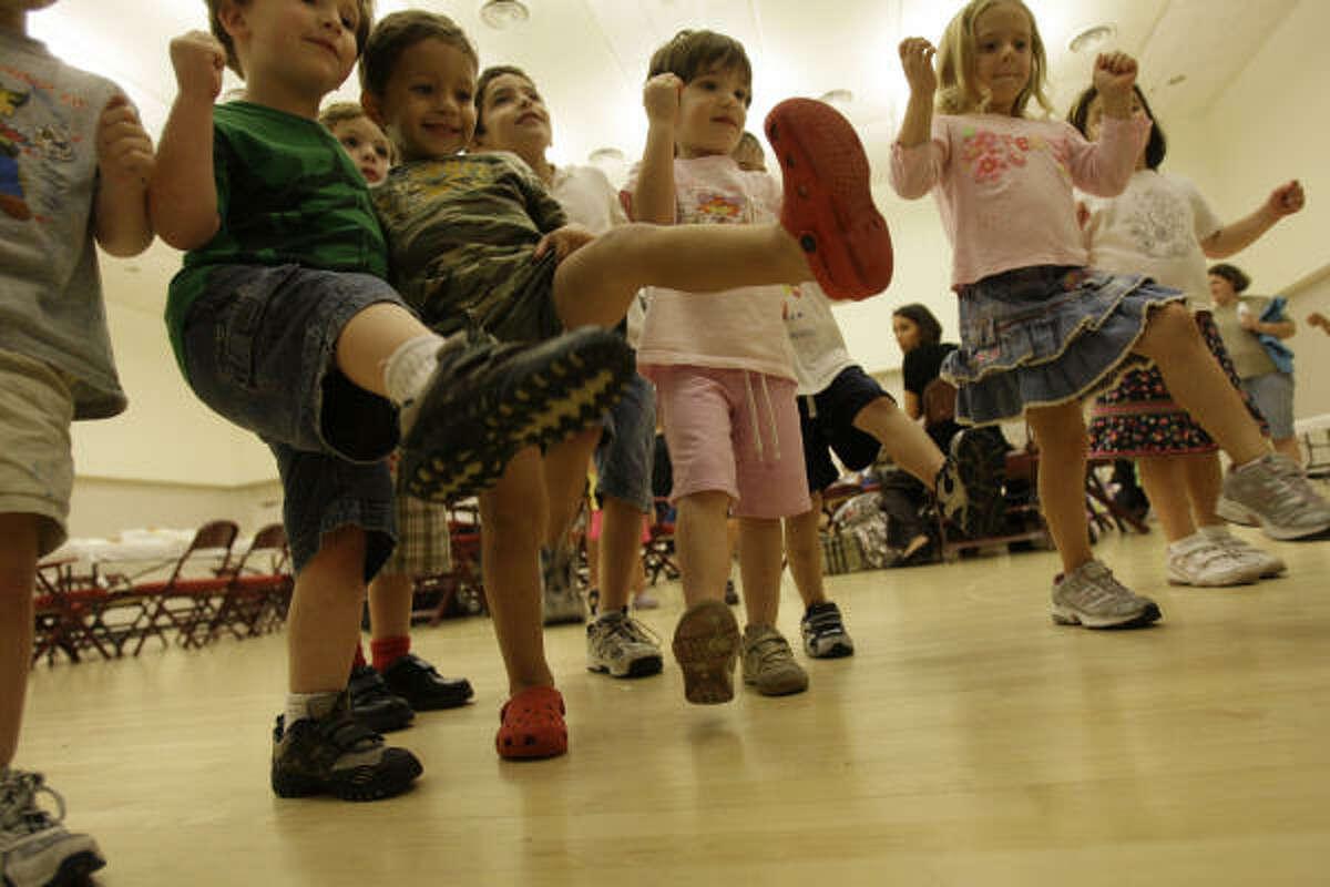 Bertha Alyce Center preschoolers dance to a song about building a sukkah.